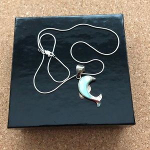 Sterling silver dolphin necklace with chain.